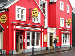 a red pinted hotel in Dingle, Ireland