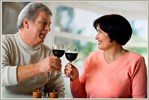 couple holding wine glasses in Florida