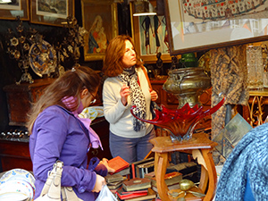 women looking at antiques in a shop in Brussels