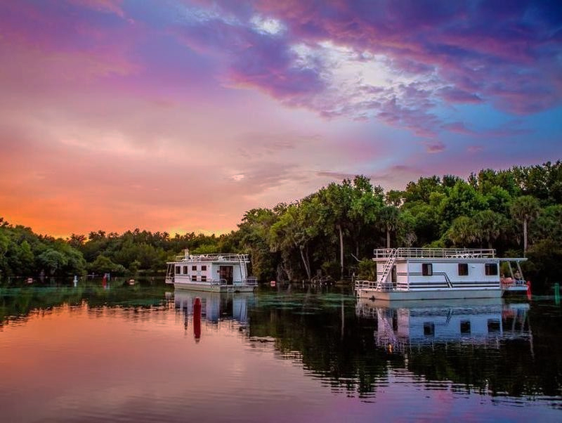 houseboats on a river at dusk in Florida