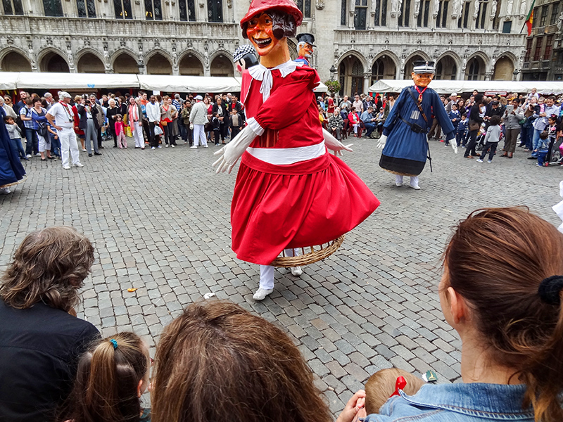 large paper mache characters dancing in a square in Brussels
