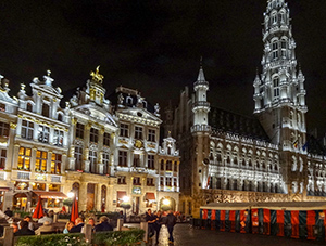 old european buildings lit up at night in Brussels
