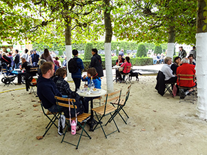 man sitting at a table in a park in Brussels