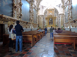 an ornate chapel in a church, one of the places to see in Puebla