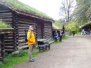 man in front of a log cabin in Orlo