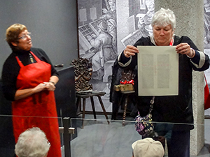 woman reading a page in the Gutenberg Museum, one of the small European museums