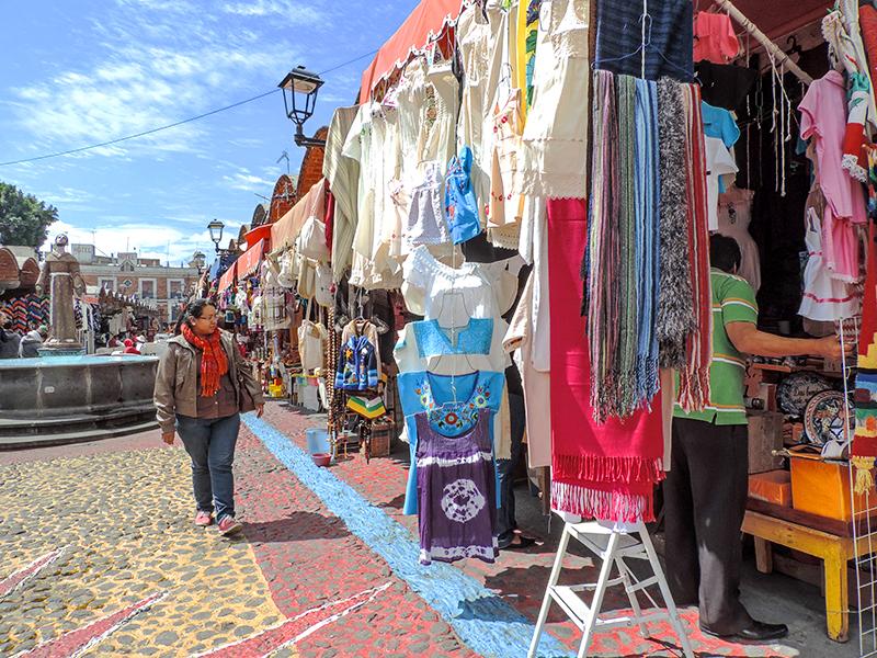 woman walking through an outdoor market