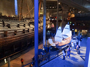 people looking at a large wooden warship