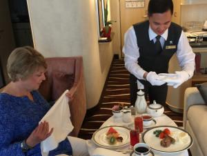 a butler serving breakfast
