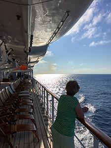 woman at railing of a cruise ship