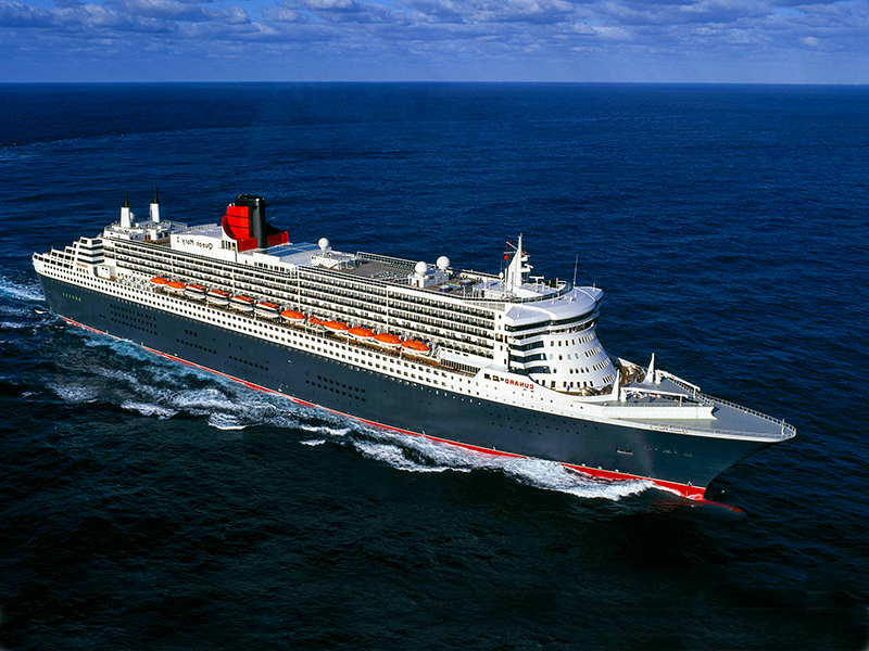 an aerial views of the Cunard Queen Mary 2 underway