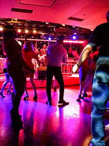people dancing at a club aboard the Eurodam