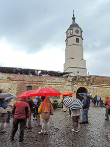 people standing by a tower