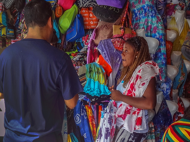 salesgirl in a market in the Bahamas
