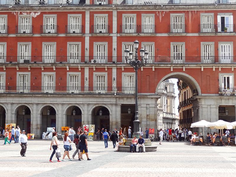 people walking across a plaza in Madrid