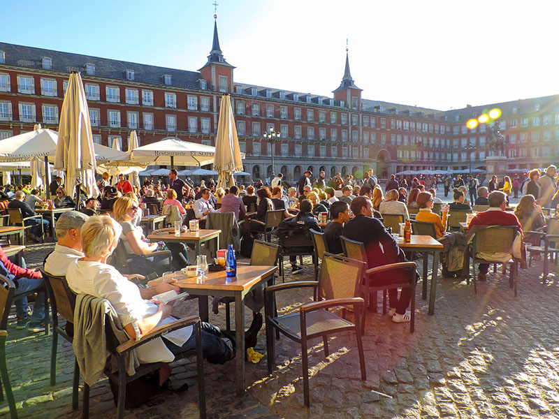 people in an outdoor cafe in Madrid