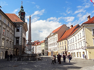 people in a European square by old buildings