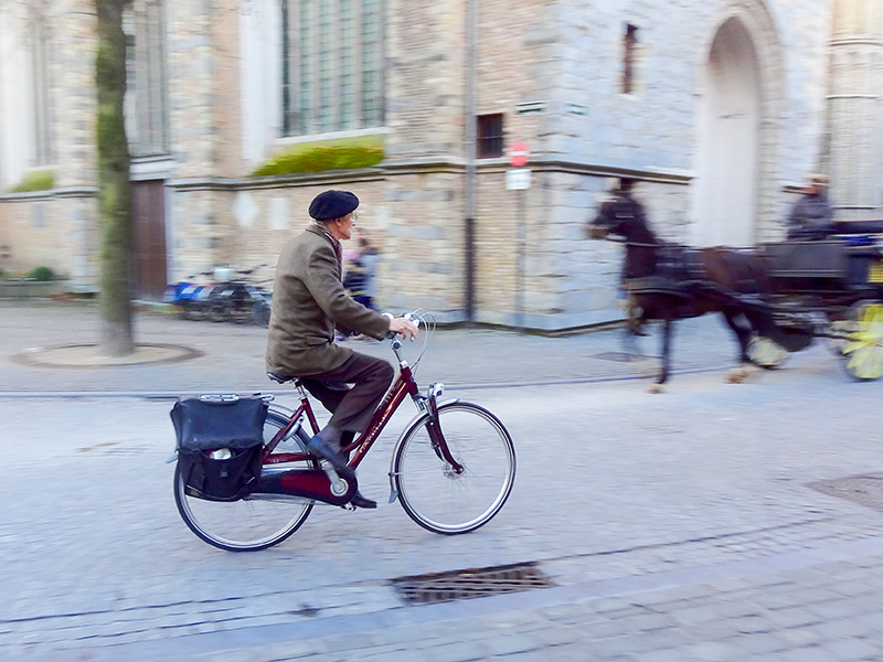 man on a bicycle Bruges, Belgium