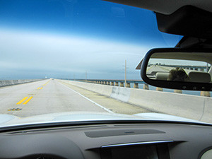 a roadway seen from a car - rental car insurance