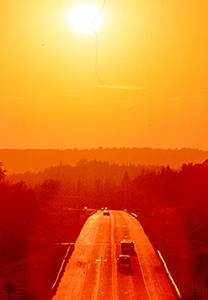 A highway at sunset - rental car insurance