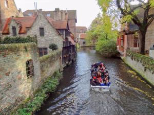 A canal boat in Bruges traveled to by train