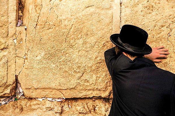 man at wall in Jerusalem