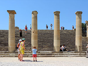 people standing by ancient Greek columns