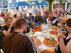 people at a table eating food in Europe