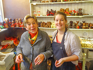 Traveling in belgium the best places to see two women in a chocolate shop in belgium solutioingenieria Gallery