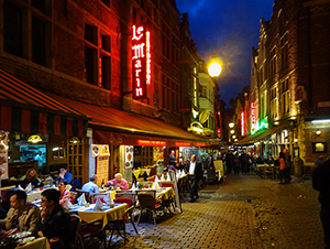 outdoof restaurants on an old city street in Belgium