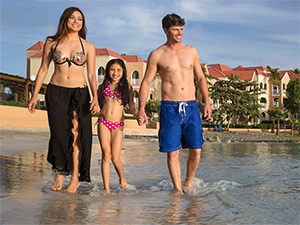 family walking along a Caribbean beach