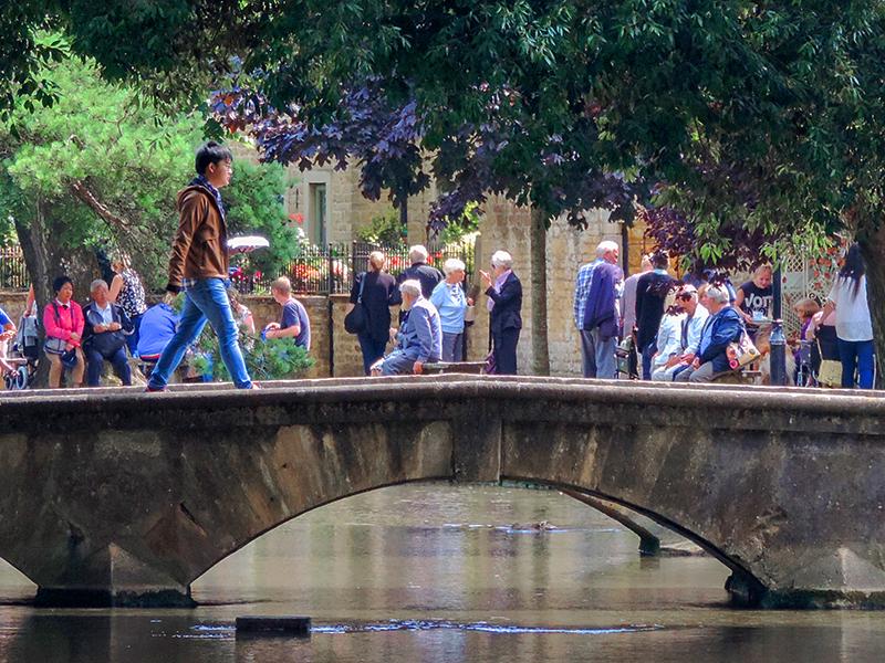 Boy walking across a bridge on day trips from London