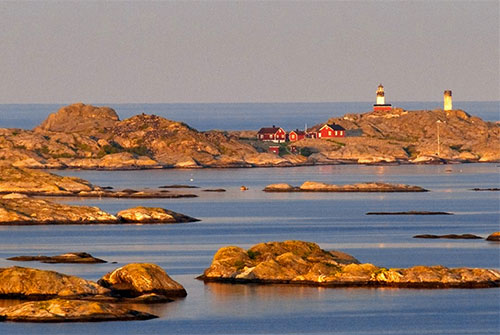 a lighthouse on a rocky islet in Sweden