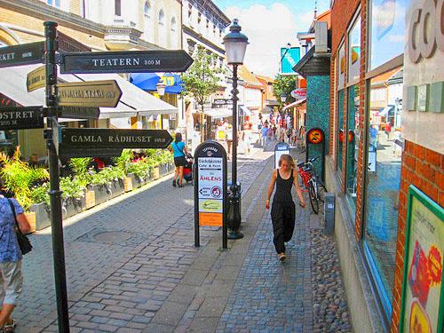 a woman walking on a street in Sweden