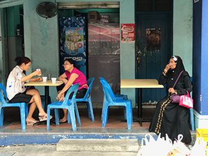women sitting in a cafe in Singapore