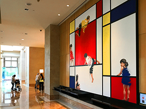 a large painting in a hotel lobby in Singapore