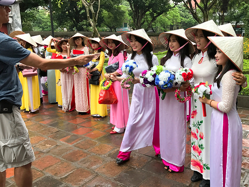 young women in colorful dresses in Hanoi