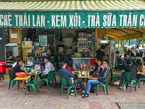 people sitting in a cafe in Hanoi