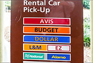car rental signs at an airport