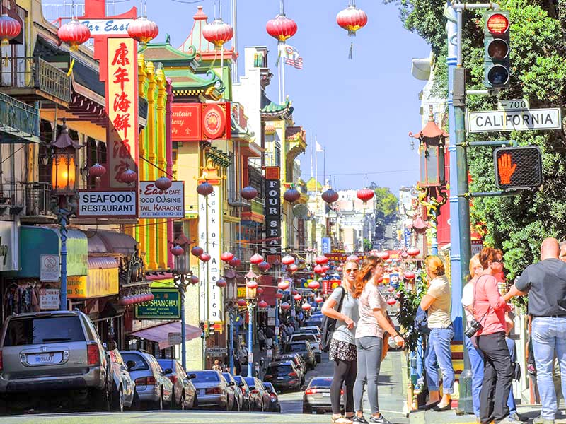 people on a street in CHinatown in San Francisco