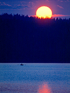 a rowboat on a lake at sunset in Finland in Scandinavia