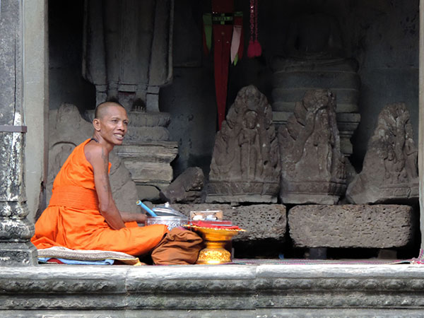 a Buddhist monk in Angkor Wat, Cambodia