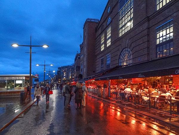 people in a restaurant Aker Brygge Oslo Norway