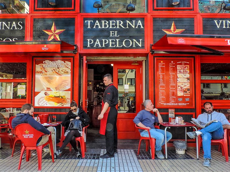 people at a cafe in Seville
