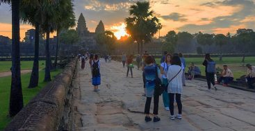 people looking at a sunrise in Angkor
