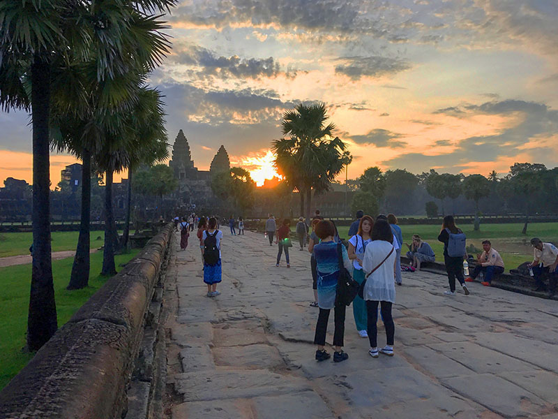 people looking at a sunrise in Angkor Wat Cambodia