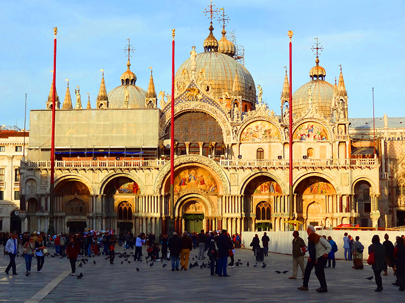 people in front of an ornate basilica in Venice, Italy
