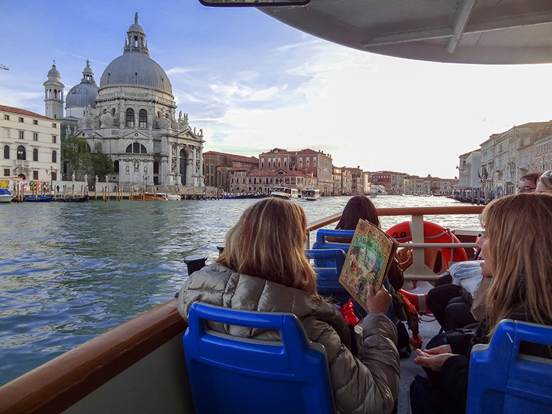 people on a ferry in Venice, Italy