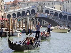 gondolas and a brudge in Venice, Italy