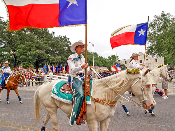 horsemen in a parade on the Chisholm Trail in Texas